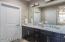 Abundant vanity storage under Carrera marble with double sinks