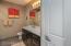 Guest Bathroom has large linen closet