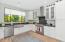 Kitchen with Wolf Range, custom cabinets