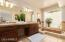 Bright and cheerful! His and her sinks, plenty of storage and counter space
