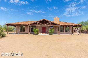 This u-shaped home was custom designed by its only owner based on a combination of traditional Mexican hacienda styling, as well as the classic American ranch style single story home layout.