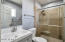 Tiled shower, crystal clear glass doors, new toilet, new hardware, new shower and sink fixtures, new vanity with large basin sink