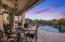 The covered patio provides plenty of room for outdoor dining and enjoying sunsets and mountain views.