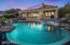 The LED lighting in the pool gives a beautiful ambiance to this custom designed backyard.
