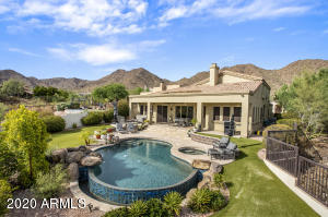 Enjoy mountain views from all directions in this backyard paradise complete with a refreshing pool and spa.