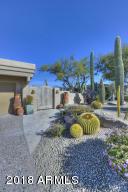 Professionally landscaped. Lush, mature desert setting.