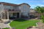 Spacious and well designed back yard with pool, artificial turf, pavers, fire pit, and built in BBQ