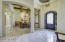 The arched iron door leads to the open floorplan.