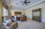 A very spacious master bedroom overlooking the pool and rear yard.
