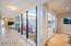 Atrium throws additional light as you enter the home.