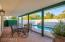 Covered patio facing east , with mature landscaping , and private heated pool and spa.
