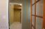 Past dining room towards bonus room and inside laundry