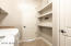 Laundry area with drop station and walk-in closet.