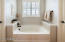 Feel calm and relaxed in your deep soaker tub.