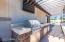 Beautiful pergola covered outdoor kitchen.