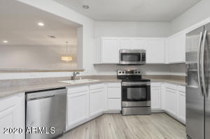 Fresh white cabinets and matching stainless steel appliances!
