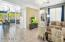 Open floor plan from kitchen to living room spaces.
