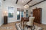 Formal dining, currently used as office, wine fridge and built-in cabinets