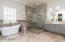 Designer accents, plantation shutters and stone shower