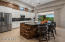 The gourmet kitchen features Viking and Kitchen Aid stainless appliances, and an oversized island/breakfast bar.