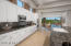 The kitchen is light and bright with newly painted cabinetry and high end appliances.