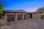 Garage doors were recently stained, and the garage features ceiling fans, storage racks, and 3 bays.