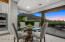 Enjoy sunset and mountain views from this casual dining room that features butted glass windows.