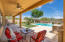 The patio extends the entire length of the home and notice the open space behind the home!