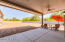 This side yard is plenty big enough for an RV garage, storage of all your toys, or even makes the perfect garden space!