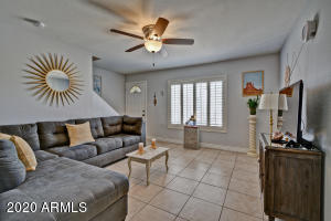 Light and bright living room, custom plantation shutters throughout