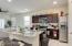 Gorgeous granite counters, espresso colored cabinets, kitchen Island.