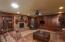 Family room w/ woodburning brick fireplace