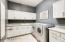 Remodeled laundry room with granite counters & built-in ironing board
