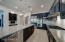 Granite counters, travertine floors, gourmet kitchen with double ovens and built in fridge.