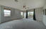 Oversized master bedroom with double doors to outdoor patio.