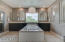 Master bathroom is a showstopper with his and hers vanity and soaking Jacuzzi tub.