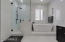 Luxurious master bath with wall to wall tile
