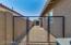 Dog run leads to courtyard