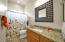 Granite counter and full shower are perfect in this 2nd bathroom