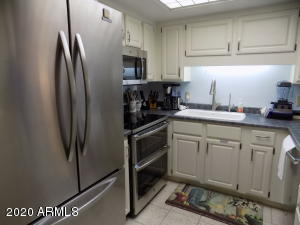 Beautiful, highly upgraded stainless steel appliances, white washed cabinets, new counter top, new sink and faucet and tile flooring