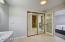 Master Bath with mirrored closet doors