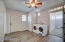 Spacious Laundry room with entrance to the back covered patio and side parking
