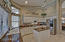 Spacious kitchen with granite counters and plenty of cabinet space.