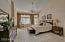 Spacious master bedroom with double doors, private entry to back patio and soaring ceilings.