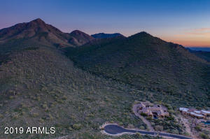With 3.02 Acres and backing to a Mountain this evaluated lot provides additional privacy.