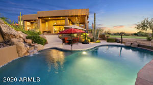 CASCADING WATER FALL INTO LARGE POOL WITH VIEWS. POOL & SPA HAVE PEBBLE SHEEN, RESURFACED COOL DECK & NEWER ADDED TRAVERTINE PAVERS.