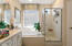 Master bathroom with separate shower and tub
