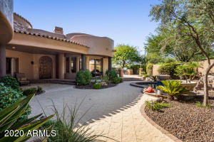 Low maintenance and easy living with a front courtyard that is set up for relaxing or entertaining.