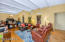 Living room and formal dining room with high beamed ceiling