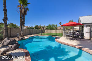 Large back yard with sparkling blue pool!